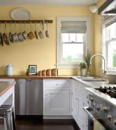 wall ideas for kitchens pale yellow wall color with white kitchen cabinet for country styled kitchen ideas with white