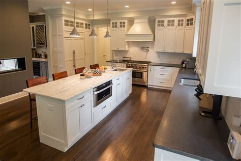 White Cabinets paired with Dark Countertops; Kitchen Design