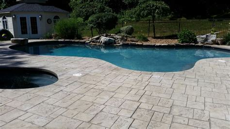 picture  stamped concrete pool deck unsealed