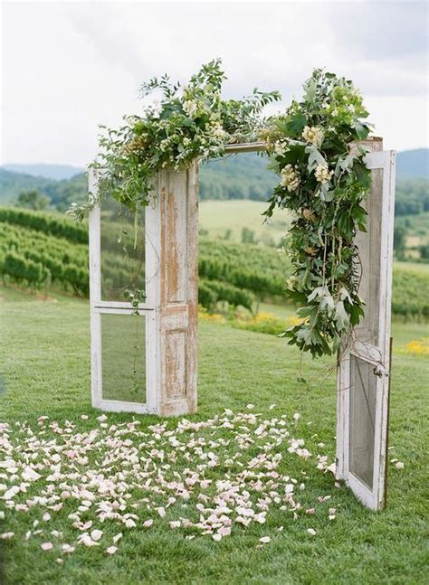 outdoor wedding arch inspo for a rustic themed wedding
