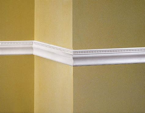chair rail fashioned wooden molding fixes to a wall