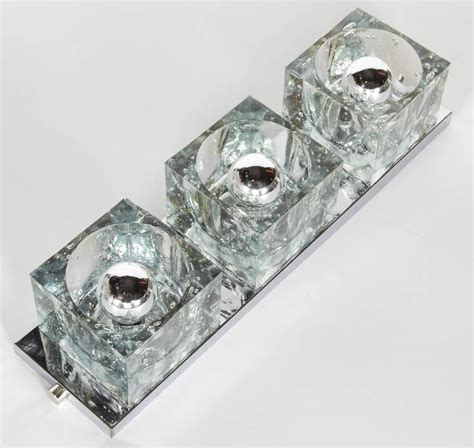 mid century modern wall light with large glass block