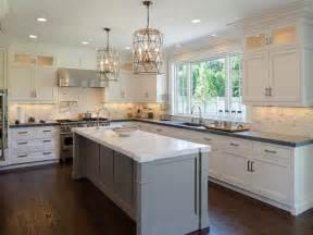Aristokraft Oak Kitchen Cabinets by Faceted Light Pendants Transitional Kitchen Blue