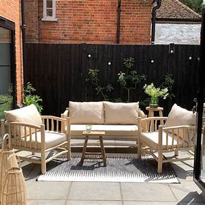 rustic wooden framed garden sofa and two armchairs set