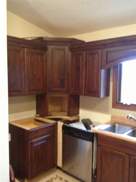 angled corner kitchen cabinets crown return to angled corner cabinet finish carpentry 4067