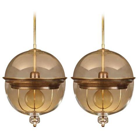 bronze globe pendant light glass globe with bronze pair of pendant lights italy