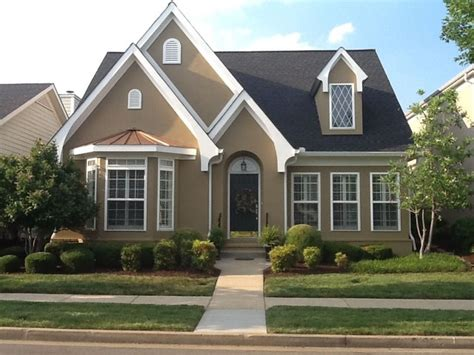 simple living wing accent tudor style stucco traditional exterior nashville