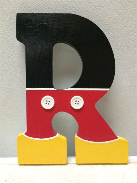 items similar  mickey mouse hand painted wooden letter  etsy