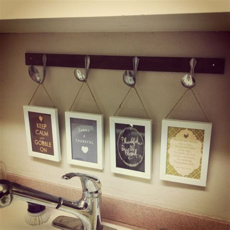 Collection by hanging wall decor. $10 DIY kitchen decor project - $1 pine from Home Depot (stained), 25 cent thrift store spoons ...