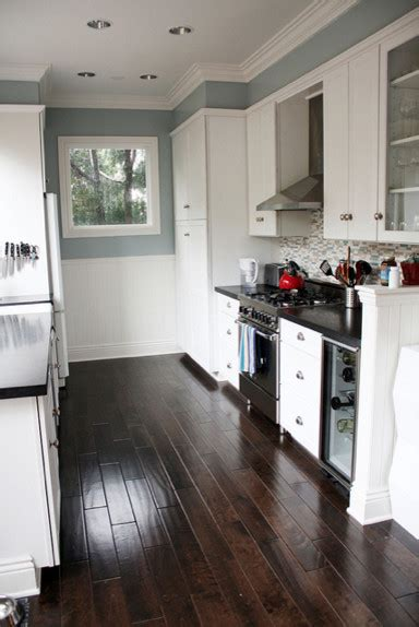 blue gray kitchen  black counter tops  white cabinets