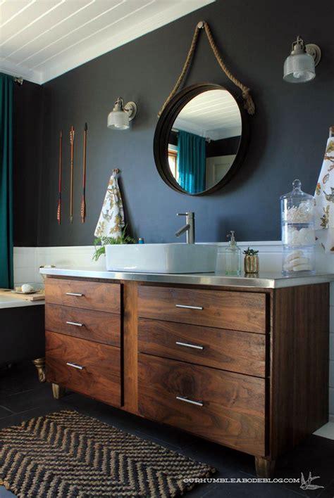 single countertop sink double cabinet wooden dresser vanity charcoal black wall paint