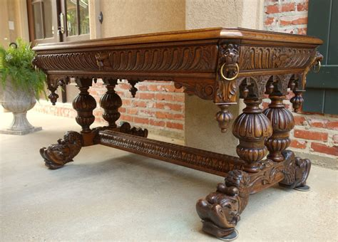 antique french victorian carved tiger oak dolphin table