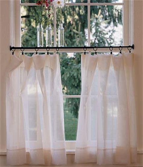 thinking of doing a half tiered curtain in living room