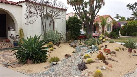 streambed in a desert garden with style home