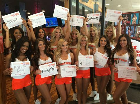 hooters girls raise money  breast cancer awareness