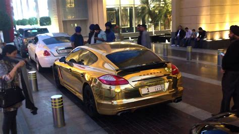 golden porsche panamera turbo  ksa dubai dubai mall