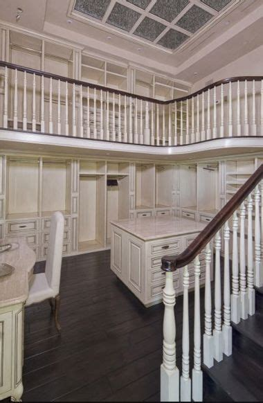 two story master wardrobe with make up vanity island and