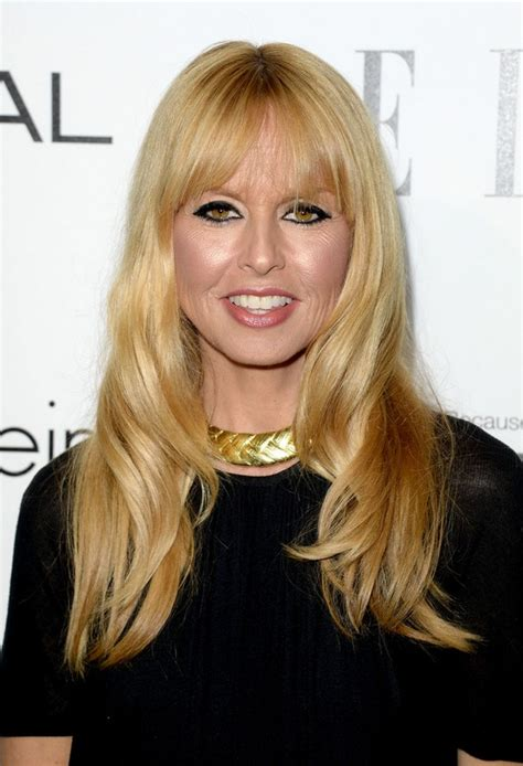 rachel zoe long soft wavy hairstyle with wispy bangs for