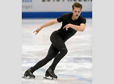 US Figure Skating Alexander Johnson comforted by an old