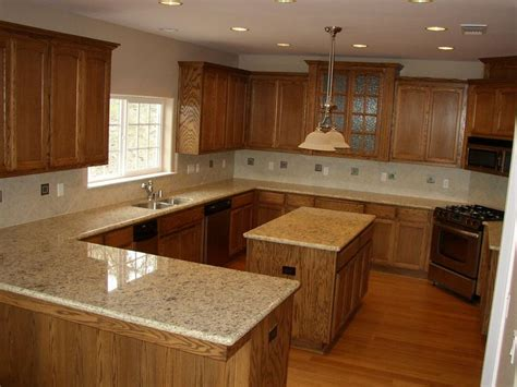 honey oak kitchen cabinets with granite countertops 37 best images about granite countertops with oak cabinets