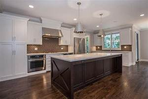 white and brown kitchen features white shaker cabinets With white and brown kitchen designs