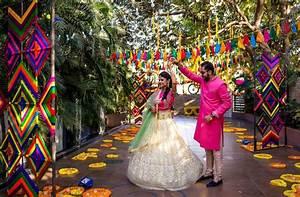 Mela Themed Colorful Mehndi Sangeet Wedding Photography