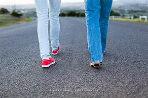 Two people walking together down an open road | (Buy at ...