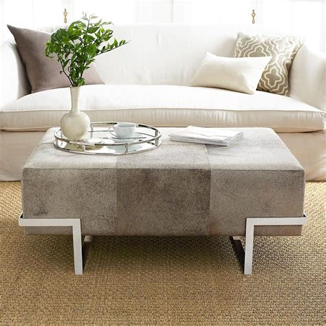 10 coffee table ottomans for an inviting living room. Designed in-house, this real cowhide ottoman works well to not only give your feet a rest, but ...