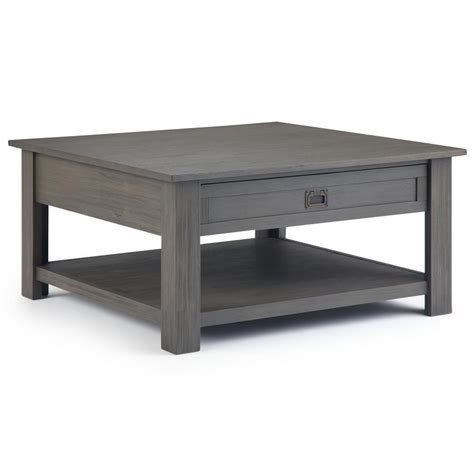 Classic square coffee table with painted base and rustic stained table top complete with bottom shelf for storage. Simpli Home Monroe Solid Acacia Wood 38 in. Wide Square Rustic Contemporary Square Coffee Table ...