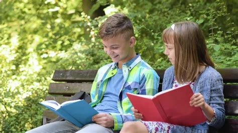 Boy And Girl Reading Book By Valiza Videohive