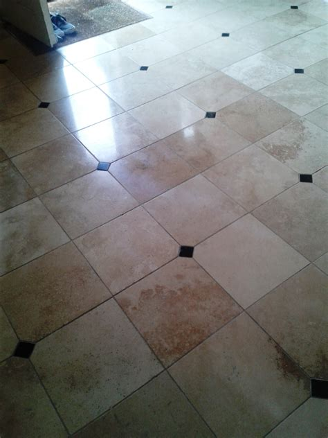 cleaning filling and burnishing travertine tiles in