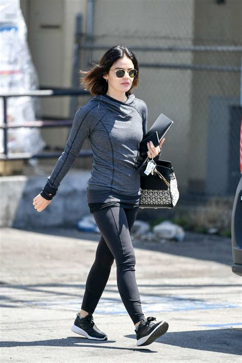 lucy hale sports grey hoodie and black leggings as she ...