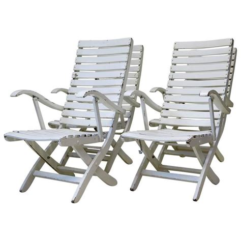 set of four folding wooden deck chairs circa