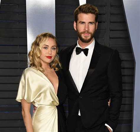 dlisted miley cyrus says she and liam hemsworth have
