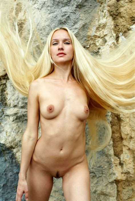 Naked Long Haired Blonde Posing On The Rocks Near Sea