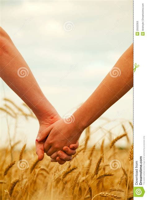 Young Couple Holding Hands Stock Photos - Image: 25522353
