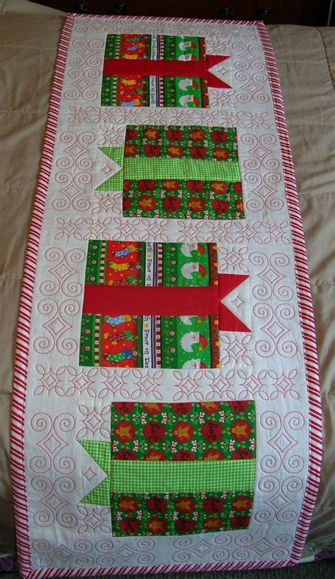quilted christmas table runner gift boxes red and