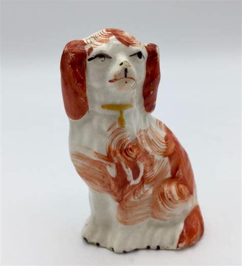 antique small staffordshire dog figurine