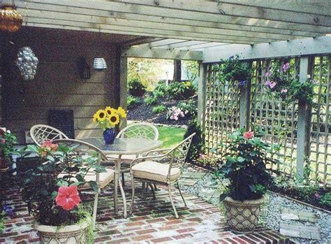 bi level brick patio with lattice fencing eclectic
