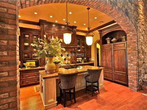 tuscan kitchen with pendant lights and arch the