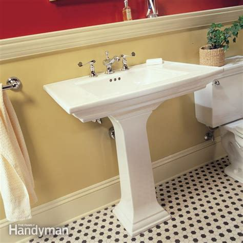 how to attach a pedestal sink to the wall how to plumb a pedestal sink the family handyman bathroom