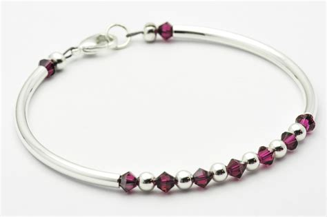 Ruby Swarovski July Birthstone Bracelet  Black Brook Shop. Inlaid Engagement Rings. Brand Name Watches. Chic Watches. Womens Diamond Ring Bands. Eternity Band Emerald. Mens Jewelry. Best Jewelry. Big Stone Earrings