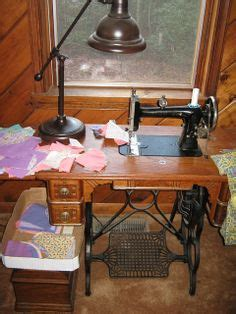 1880 s wheeler sewing machine the machine drops into the bottom cabinet so that it turns into a