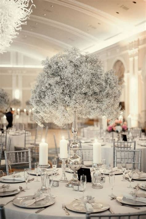 silver and baby's breath winter tall wedding centerpiece