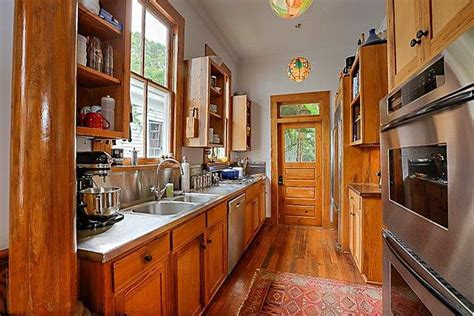 wide plank pine tiny bungalow house is acorn sized
