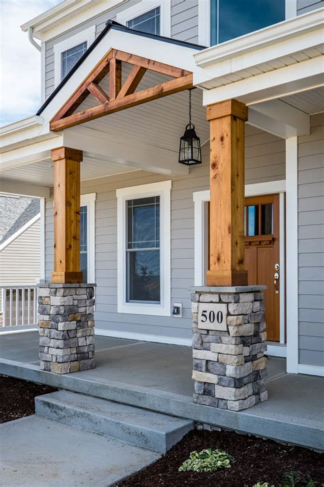 gorgeous front porch wood  stone columns   house  porch porch pillars front