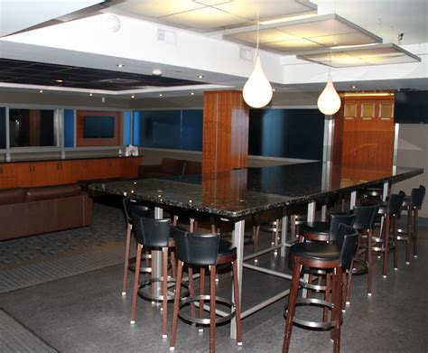 Table Chairs Edmonton by Edmonton Oilers Locker Room Players Lounge Granite Table
