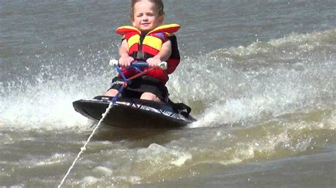 4 yr old doing tricks on the kneeboard - YouTube