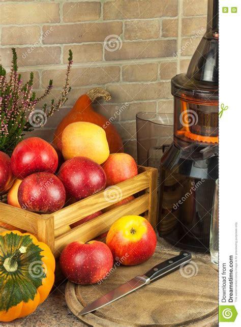 juicing apples processing juicer autumnal preparing juices juice fruit fresh apple healthy kitchen homemade