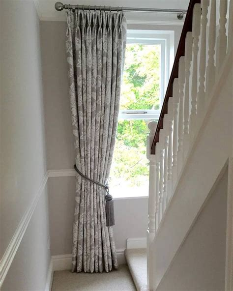 muted tones we this beautiful pinch pleat curtain